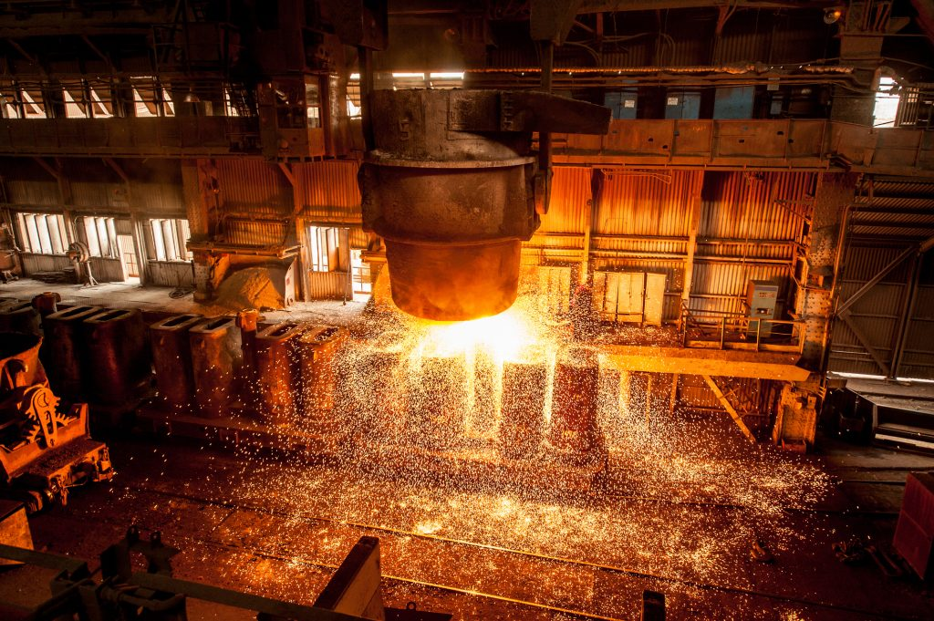 Tank pours the liquid steel in the forms. Steel mill.